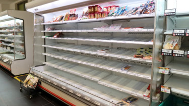 Supermarket shelves have been cleared out as people prepare for Typhoon Hagibis in Yokohama.