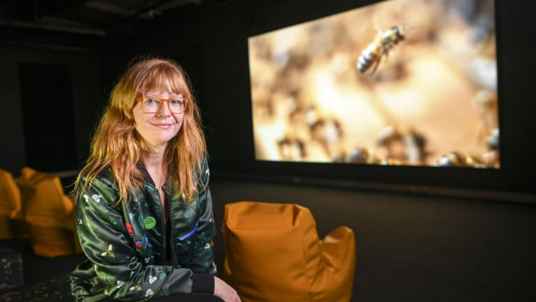 Artist Zanny Begg in front of her work The Beehive at ACMI.