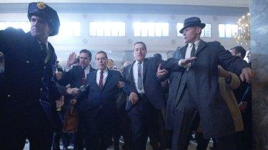Ray Ramano as Bill Bufalino with a digitally de-aged Al Pacino as Jimmy Hoffa and Robert De Niro as Frank Sheeran in The Irishman.