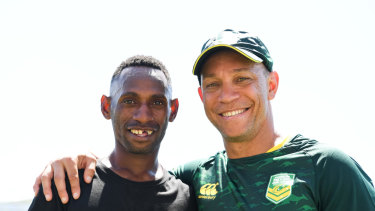 Good mates: Kangaroos assistant coach Adrian Lam and Nelson Saimon.