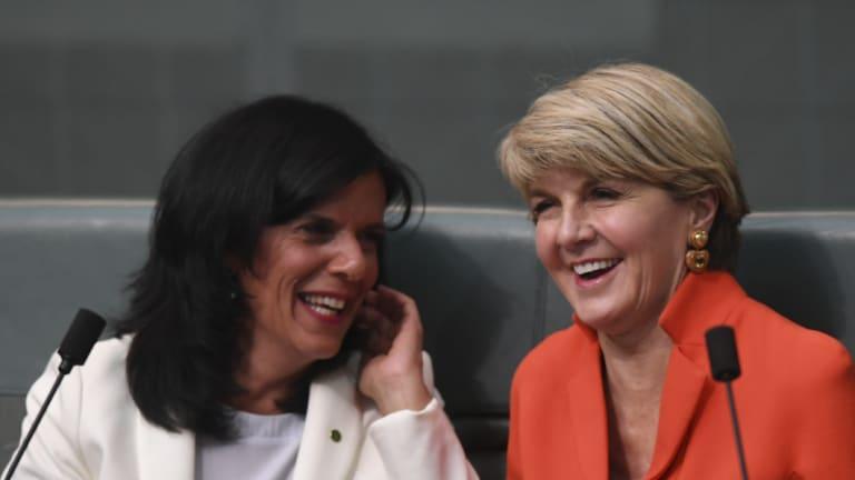 Former Australian foreign minister Julie Bishop (right) speaks to Liberal backbencher Julia Banks.