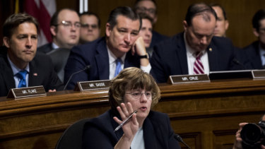 Phoenix prosecutor Rachel Mitchell questions Christine Blasey Ford during the Senate Judiciary Committee hearing as Sen. Ben Sasse, R-Neb., Sen. Ted Cruz, R-Texas, Sen. Mike Lee, R-Utah., listen, Thursday, Sept. 27, 2018 on Capitol Hill in Washington.