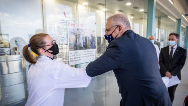 Prime Minister Scott Morrison last week as he was shown the CSL Lab where a COVID-19 vaccine is being worked on. While a vaccine is on the way, many economies are likely to bear COVID scars for years.