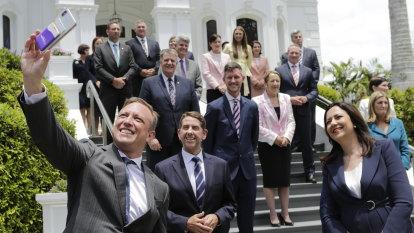 Premier defends growing team as cabinet members sworn in