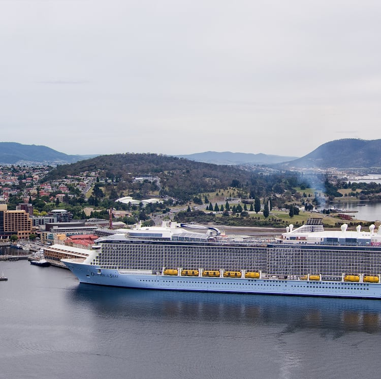 The cruise ship Ovation of the Seas arrives in Hobart in 2016; such tourist-filled vessels are a boon for Tasmania's economy.