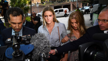 Australian swimmer Shayna Jack (centre) is seen arriving for a briefing with ASADA in Brisbane on Friday.