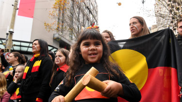Some of the hundreds of people took part in a NAIDOC Week march in Melbourne on Friday to celebrate Aboriginal and Torres Strait Islander culture.