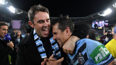 We did it: NSW coach Brad Fittler congratulates his halfback Mitchell Pearce after game three.
