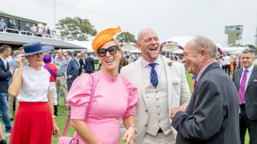 Zara and Mike Tindall share a laugh with Gerry Harvey at the Magic Millions raceday on Saturday.