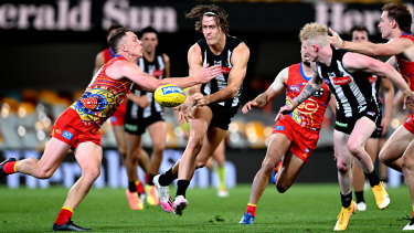 Darcy Moore of the Magpies gets a handball away during the round 17 AFL match between the Collingwood Magpies and the Gold Coast Suns at the Gabba on September 14.