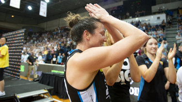 Kelsey Griffin is overcome by emotion after the Canberra Capitals won the WNBL championship.