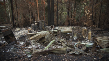A destroyed home is seen one month after a bushfire swept through the region.