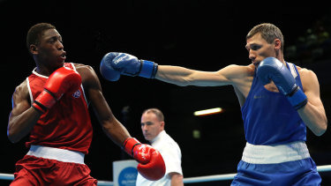 Spain's Youba Sissokho Ndiaye and Russia's Andrei Zamkovoi fight on day three of the Olympic qualifying event in London on March 16.