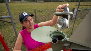Professor Janet Davies collecting pollen from the pollen trap at Rocklea.