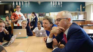 Then PM Malcolm Turnbull with Michelle Simmons (second from right) observing how a high-school class use computers. Turnbull championed tech innovation but after he was ousted his party dropped the idea.