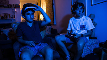 Billy Graham and Benjamin Baskin, both 13, play Fortnite at home in Stanmore.