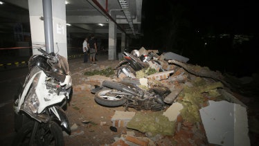 Debris fell on top of a motorcycles after the earthquake in Bali.