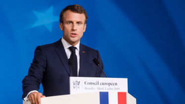 French President Emmanuel Macron speaks during a news conference following an EU leaders summit in Brussels.