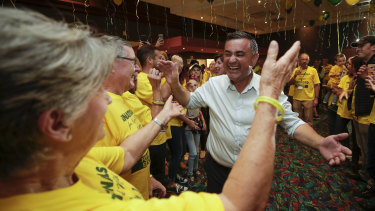 NSW Deputy Premier John Barilaro celebrates with supporters after claiming victory during his election night function at the Queanbeyan Kangaroo Leagues Club.
