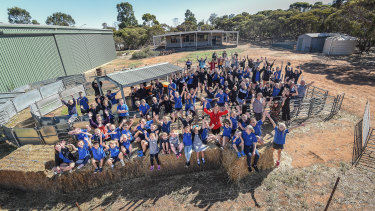 Murrayville Community College students pose for a photo in the school's sheep yard