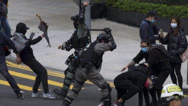 Riot police clash with protesters as the pro-democracy protests continue in Hong Kong.