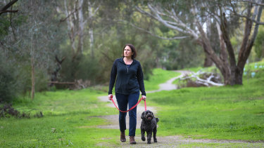 Manningham Council mayor Paula Piccinini takes Daisy the dog for a walk through Bulleen Park, which is under dispute.