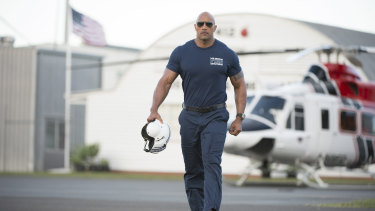 Dwayne Johnson at Brisbane's Archerfield Airport for a scene in the 2015 movie San Andreas. He will return to Queensland to shoot Young Rock.