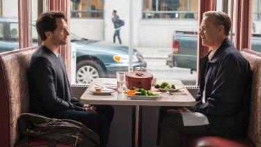 Matthew Rhys plays a journalist interrogating Fred Rogers (Tom Hanks) in A Beautiful Day in the Neighborhood.