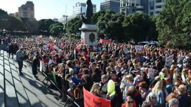 Some 50,000 teachers walked off the job over a pay dispute ahead of the government's annual budget. Here they gather outside Parliament in Wellington.