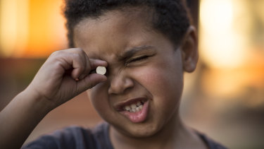 Three-year old Trent swallowed a button battery like the one he is holding. He was lucky to survive.