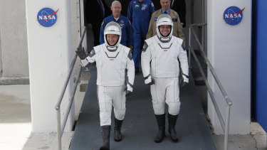 NASA astronauts Douglas Hurley, left, and Robert Behnken wave as they make their their way to Pad 39-A, at the Kennedy Space Centre in Cape Canaveral, Florida.
