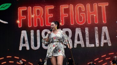 Celeste Barber on stage as MC at Fire Fight Australia Bushfire relief concert.