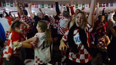 Croatian fans at the King Toms Club in Edensor Park celebrate Croatia's equaliser.
