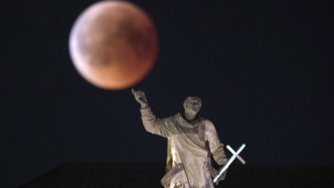 The moon turns red during a total lunar eclipse, as seen from Dresden, Germany.