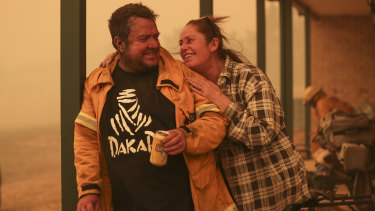 Bumbalong residents Laurence and Claire Cowie were happy they were able to save their home.