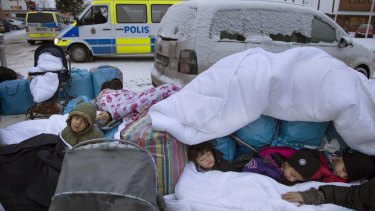 Migrant children  from Syria sleep outside the Swedish Migration Agency's offices, in Marsta, Sweden, in 2016. Sweden has since clamped down on what were some of the world's most open migration policies.