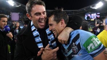 NSW coach Brad Fittler congratulates his halfback Mitchell Pearce after the Blues' series win last year.