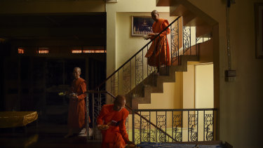 Female  monks descend from the prayer hall after a ceremony.