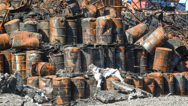 Burnt-out chemical drums after the fire at the West Footscray factory last year.