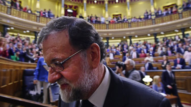 Spain's Prime Minister Mariano Rajoy leaves the Spanish parliament after a motion of no confidence vote in Madrid on Friday