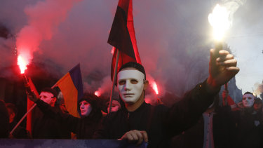 Ukrainian nationalists light flares during a rally marking Defence of the Homeland Day in Kiev.
