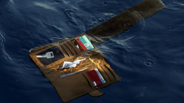 A wallet belonging to a victim of the Lion Air crash floats in the waters of Ujung Karawang, West Java.