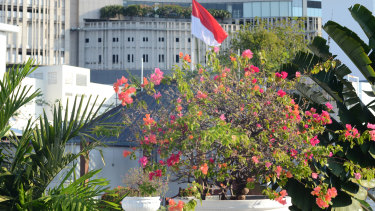The Indonesian flag flies over the Hotel Majapahit. In 1945, when Dutch colonists raised the colonial red, white and blue flag here, Indonesian nationalists stormed the hotel and tore the blue off the flag.