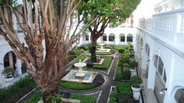 The courtyards of the Hotel Majapahit are immaculately maintained.