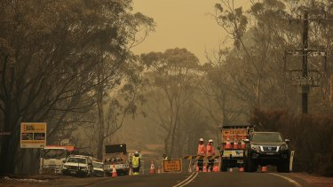 A police road block on Wilson Road between Buxton and Balmoral. The road has been closed due to the Green Wattle Creek fire.