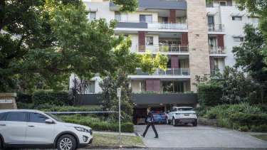 Police establish a crime scene at a unit block at Pymble after a woman's body was found in a freezer.