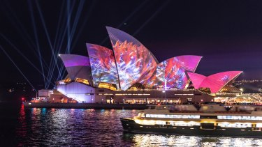 The sails of the Opera House are lit up with an animated Austral Flora Ballet by Andrew Thomas Huang.