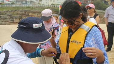 Migrants receive a lesson in beach safety at Tamarama.