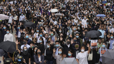 Protesters hold up their hands to represent their five demands as protests continue in Hong Kong on Tuesday.
