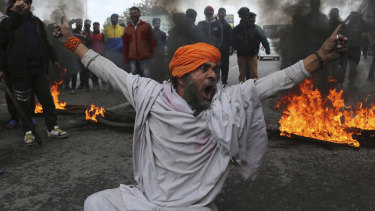 A protestor shouts slogans against the  attack on a paramilitary convoy in which 40 soldiers died in Jammu, India, last week.
